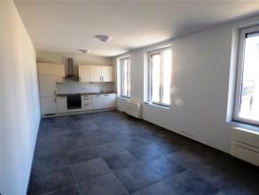 Dans lhyper-centre de Waremme, découvrez cet appartement de standing au rez de chaussée entièrement rénové avec mat