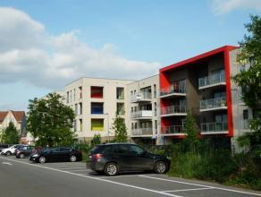 Recent appartement met 1 slaapkamer, terras en ondergrondse autostaanplaats op een zeer goede locatie nabij openbaar vervoer en het centrum van Herent