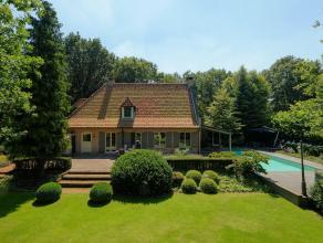 Luxueuze villa met wellness op prachtig perceel van ca 2.413m².Gelijkvloers: Ruime inkomhal met gastentoilet, L-vormige living met toegang tot he