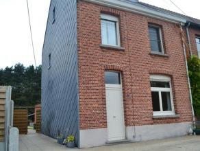 Instapklare woning met 4 slaapkamers in Gobbendonk-Bouwel. De woning heeft volgende indeling: inkomhal, leefruimte met salon en eetkamer, volledig ge&