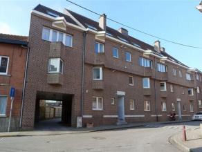 Goed gelegen gelijkvloers appartement met groot, privatief terras nabij centrum Heverlee, op wandelafstand van het station. Het appartement bestaat ui