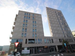Nieuwbouw-appartement met 2 slaapkamers naast het station van Leuven en met zicht over park Belle Vue. Op wandelafstand van centrum Leuven.