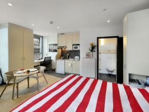 Studio DOUBLE moderne d'env. 29 m² situé à l'étage 1/10 côté rue. Séjour avec revêtement sol quick