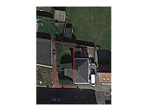 Perceel bouwgrond voor half-open bebouwing in het centrum van Rijmenam met een oppervlakte van circa 2a20ca. Noord-west georienteerd. Breedte: circa 1
