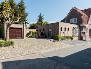 Stijlvolle woning met handels/kantoor/praktijkruimte gelegen op een perceel van 5a37ca in de Gansterenstraat 3 te Hoeselt. Rustige en commerciële