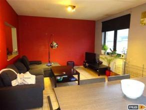 Appartement deux chambres de 65m² disposant d'une terrasse couverte et situé à proximité de toutes commodités. Hall d