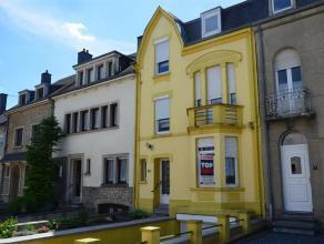 Dans le centre d'Arlon, maison de ville avec 3 chambres, jardin, caves et garage. Situation idéale à proximité des commerces et d