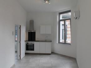 Situé rue de la Grosse Pomme 14 à Mons, bel appartement une chambre neuf au 1er étage comprenant un beau séjour avec cuisi
