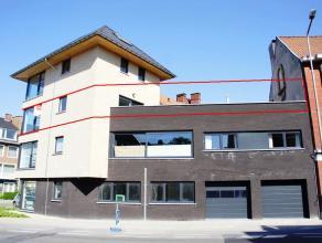 Ruim nieuwbouwappartement gelegen in de directe omgeving van supermarkt, winkels... Het appartement beschikt over een zeer ruim zuidgericht terras (33