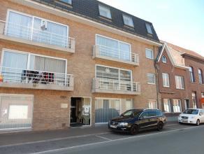 Gelijkvloers appartement met 2 slaapkamers en terras.