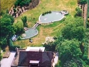 Charmant & Licht Landhuis(Villa) gelegen op een domein van 4340 m² in het mooie en bosrijke Luipegem (Bornem).Deze charmante en strategisch g