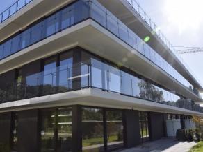 """VERRASSEND NIEUWBOUWAPPARTEMENT MET RUIM TERRAS- IN PARKZONE VLAKBIJ CENTRUMHet dak-appartement, eerste gebruik,  ligt in """"de residentie Capucienen-Ca"""