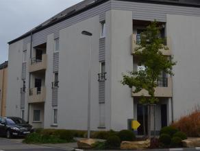 Splendide appartement deux chambres au rez-de-chaussée avec terrasse situé dans un quartier résidentiel comprenant un hall d'entr