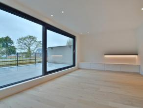 Zeer luxueus nieuwbouw appartement met 2 slaapkamers, groot terras en carport, smaakvol afgewerkt en centraal gelegen te Kalmthout-Achterbroek.