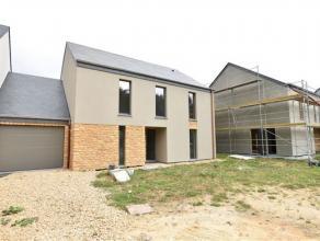 Arlon-Fouches, maison basse énergie 2 façades neuve (première occupation) sur terrain de 6,83 ares. Cette lumineuse maison est co