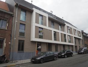 2-slaapkamer nieuwbouwapp. op gelijkvloers in centrum Tielt! Centrum Tielt op wandelafstand van openbaar vervoer, slager, bakker, bank, ... Living met