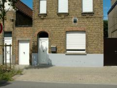 Rustig doch centraal gelegen woning op een oppervlakte van 406m2 en bestaande uit een ruime inkomhal, leefruimte,ingerichte keuken, wasplaats, badkame