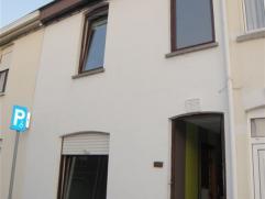 Maison d'habitation avec 3 chambres située à Herseaux, avec grand jardin. Hall d'entrée, long séjour lumineux avec cuisine