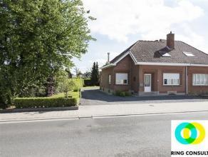 Nieuwenrode: Achter deze charmante gevel schuilt een leuke eengezinswoning (163m²) met tuin en garage. De oppervlakte van het leefgedeelte, besta