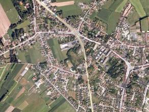 Goed gelegen projectgrond van 4.188m² langs N9 te Waarschoot nabij centrum. Zowel mogelijkheden commercieel/residentieel.<br /> - Perceelsbreedt