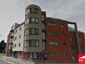 Très bel appartement récent situé au centre ville à proximité de toutes commodités, comprenant un hall d'ent