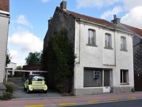 Woning met grote loods (220m²) op 7a36 in het centrum van Opwijk. Deze woning bestaat uit een salon/handels- of bureelruimte, een grote leefruimt
