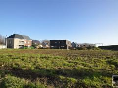 LOT 10: Bouwgrond te koop gelegen op een rustige locatie te Opwijk nabij centrum. Perceel bouwgrond met een breedte van 11,5m aan de straatzijde en ee