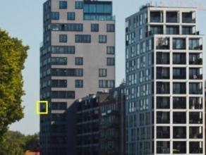 Schitterend nieuwbouwappartement van 106m² met 2 slaapkamers, terras en ondergrondse staanplaats gelegen aan de Turnhoutse Vaart. Dit appartement