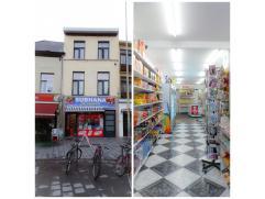 Het pand is gelegen op het Cogelsplein te Deurne, een bruisende buurt.  Het gelijkvloers heeft een totale oppervlakte van 74m² en is volledig b