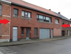 Gebouw voor gemengd gebruik, met magazijn, bureau en bovenliggend appartement, gelegen in het centrum van Onze-Lieve-Vrouw Olen. Het appartement besch