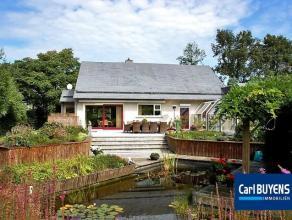 Mooie energiezuinige villa met overdekt verwarmbaar buitenzwembad, gelegen op een perceel van 1860m². Dit eigendom verkeert in de perfecte staat