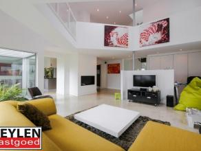 Prachtige moderne villa met 4 à 5 slaapkamers op 655m² gelegen in groene en rustige omgeving, doch vlakbij het centrum van Ravels. D