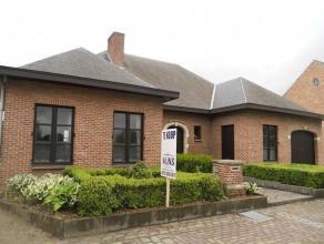 Deze riante villa is gelegen op een mooi perceel van 1019 m² in het landelijke Wiekevorst. De woning is zeer goed onderhouden  en afgewerkt met k