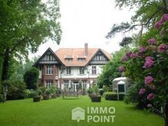 Villa op 5.897 m² met afsplitsbaar achterliggend perceel bouwgrond 16.185 m² Het Cuylitshof is een villa in typisch cottagestijl uit het beg