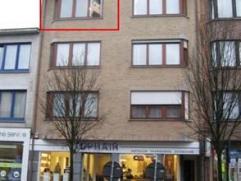 Leuk appartement met 1 slaapkamer, terras en parkeerplaats in hartje BrasschaatINDELINGInkomhal op tegelvloer met vestiaireWoonkamer op tegelsIngerich