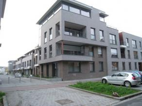 Modern gelijkvloers appartement met tuintje gelegen in het centrum van Leuven.  Het appartement beschikt over een lichtrijke, ruime leefruime met ee