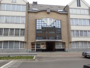 Gelijkvloers appartement met tuin en garage, in een standingvol gebouw, 'Residentie Belgrado' aan de rand van de stad en kort bij het station van Mech