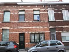 Rijwoning met 4 slaapkamers en diepe stadstuin en een voetgangersuitgang via de Elf Novemberlaan via de tuin.  op 2 a 90 ca. De woning  is reeds deel