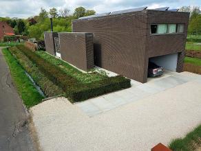 Prachtige moderne energiezuinige (zonnepanelen en verwarming via een warmtepomp) villa met veel lichtinval en ruimtegevoel en uitzicht op grote tuin e