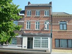 Vrij - te bezichtigen via kantoor.  Herenhuis (met kantoor), 223 m², gelijkvloers, verdiep 1 en 2, met hal, living, keuken (kasten, spoelbak, 2
