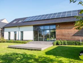 Deze volledig gerenoveerde woning met prachtig  polyvalent achter liggend gebouw is  rustig gelegen op een perceel van 45a91ca. met fraai groen uitzic