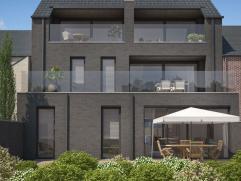Modern duplexappartement gelegen in het smaakvolle nieuwbouwproject 'De Demer' vlakbij de markt van het bruisende Bilzen. Het appartement is als volgt
