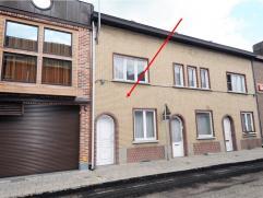 TUSSENWONING MET 2 SLAAPKAMERS EN BINNENKOER  Bewoonbare oppervlakte: 64 m² (excl. kelder en zolder) Kelder: opbergplaats en stookolietank aan