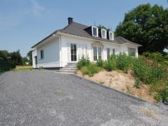 Gereonoveerde ruime woning met tuin, gunstige commerciële liggen, ideaal voor kantoor, vrije beoepen,....