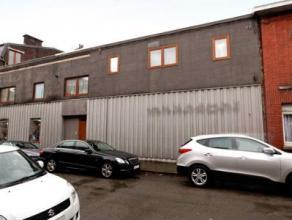 HERSTAL Centre : Bel immeuble composé d'un appartement de deux chambres et un grand garage/entrepôt, le tout actuellement loué pou