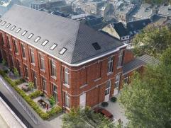 A proximité immédiate du centre et de toutes ses commodités, ce bâtiment historique, autrefois école communale, a &e