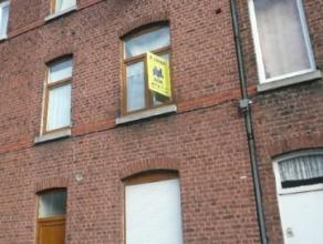 Appartement situé au 1er et 2ème étage d'une maison dans une rue calme. Il est composé comme suit: au 1er étage: un