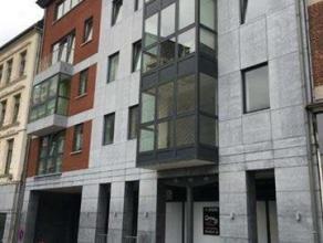 SUPERBE APPARTEMENT 2 CHAMBRES + GARAGE avec magnifque vue sur Liège dans un immeuble neuf. Composé d'un hall d'entrée, d'un spac