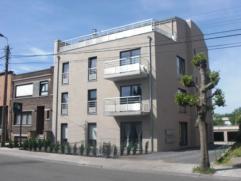 Appartement situé au 2e étage et comprenant : un hall d'entrée, un salon - salle à manger, une cuisine équip&eacute