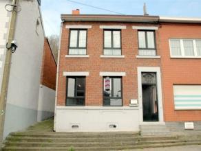 spacieuse maison de 4 chambres à rénover situé à Grâce-Hollogne proche de toutes commodités et de la place du